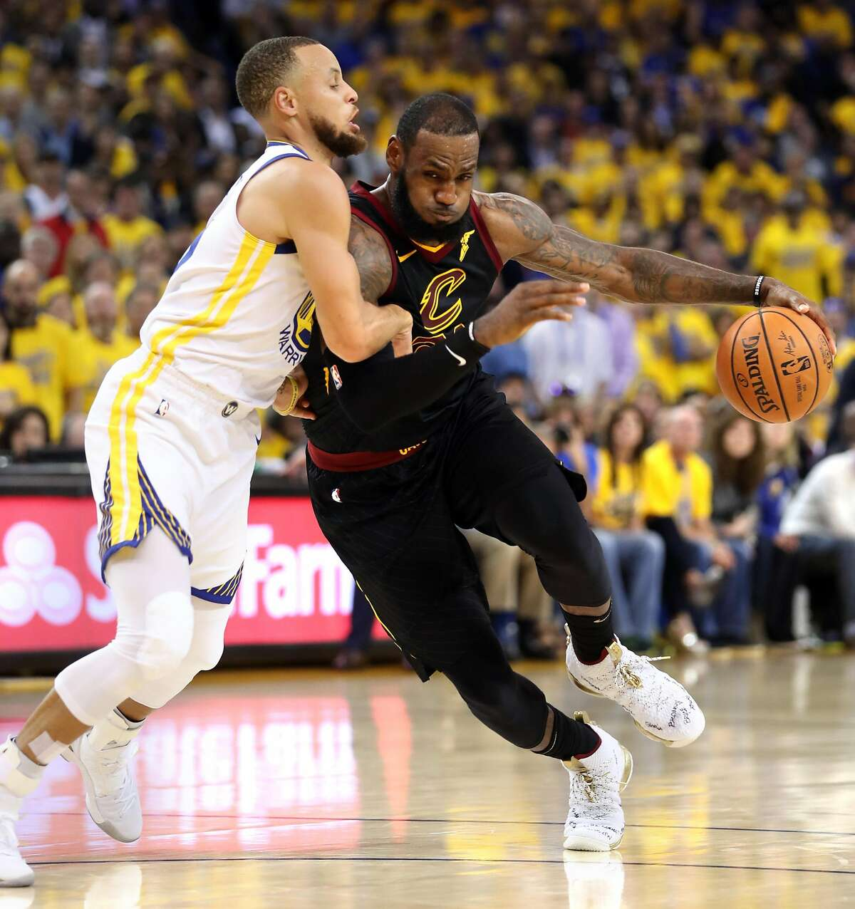 Cleveland Cavaliers' LeBron James drives on Golden State Warriors' Stephen Curry in 3rd quarter of Warriors' 124-114 win during Game 1 of the NBA Finals at Oracle Arena in Oakland, CA on Thursday, May 31, 2018.
