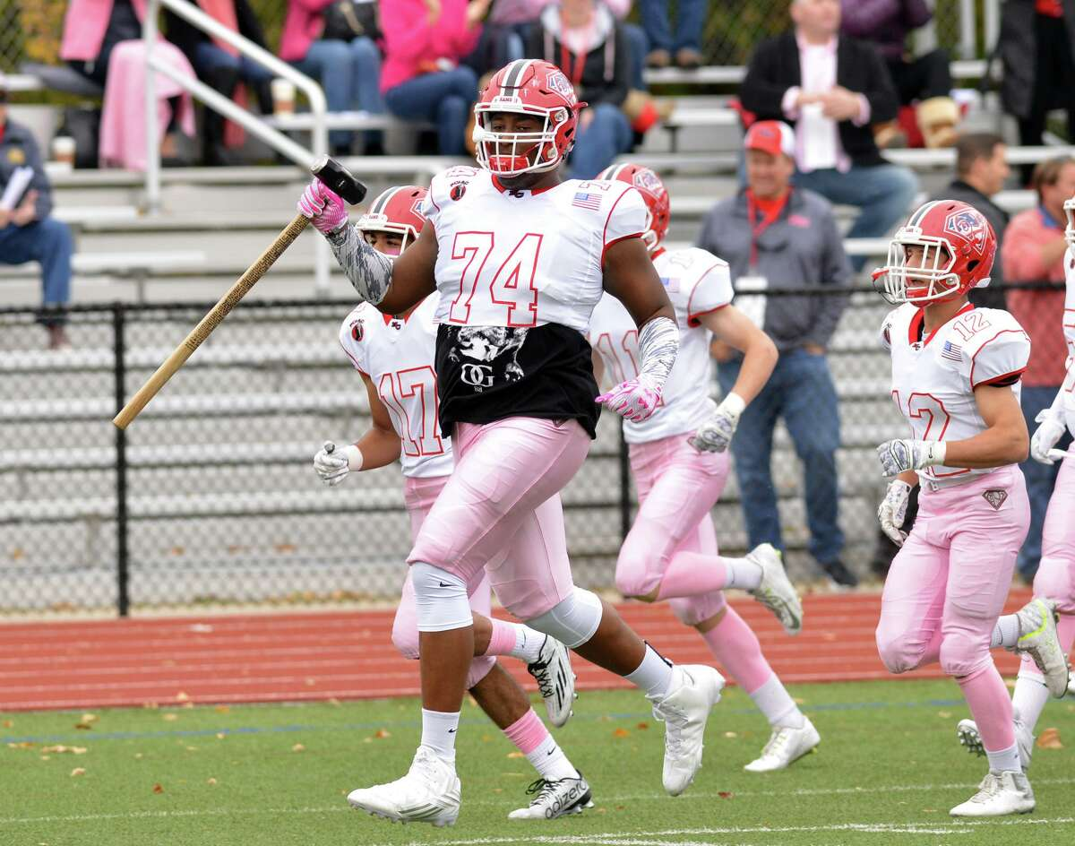 Lucas Niang (74) High school football game between Greenwich High School and New Canaan High School at Greenwich, Conn., Saturday, Oct. 24, 2015. New Canaan defeated Greenwich by the score of 24-14.