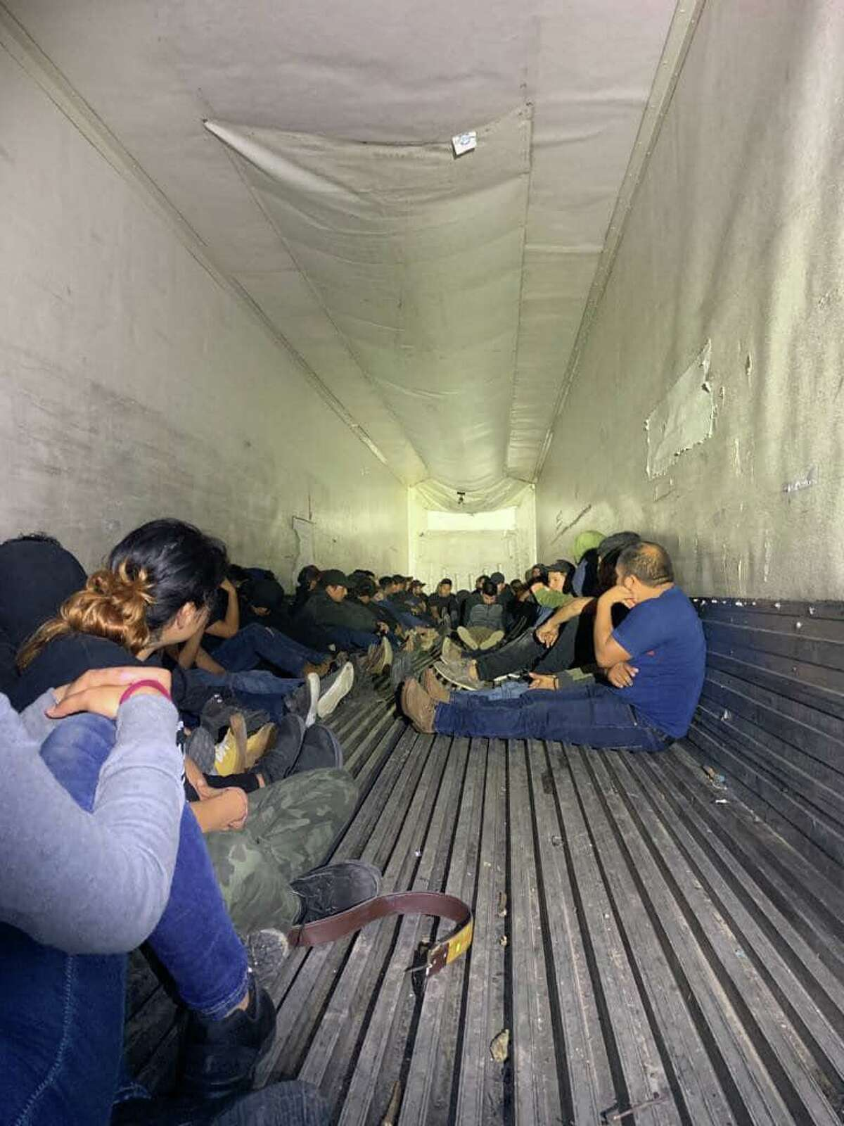 Federal and local authorities discovered 63 migrants inside a trailer.