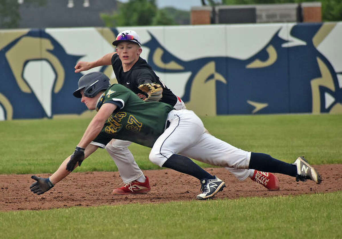 Father McGivney's Matthew Gierer avoids the tag on a stolen base attempt in the sixth inning against Nokomis on Monday in Glen Carbon.