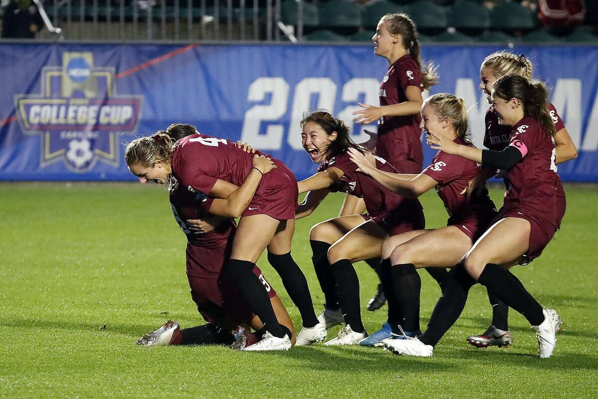 Santa Clara players celebrate their victory over Florida State at the NCAA College Cup championship in Cary, N.C.