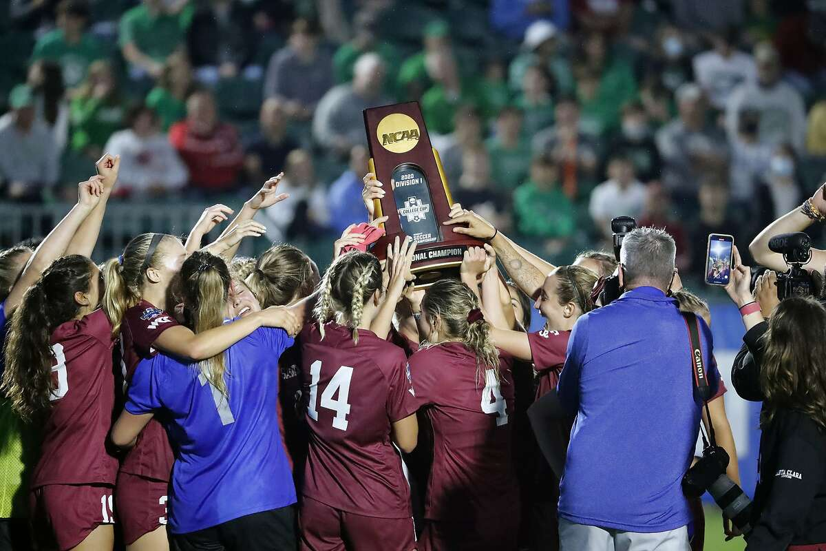 Santa Clara players hoist the championship trophy after their win over Florida State in the NCAA College Cup.