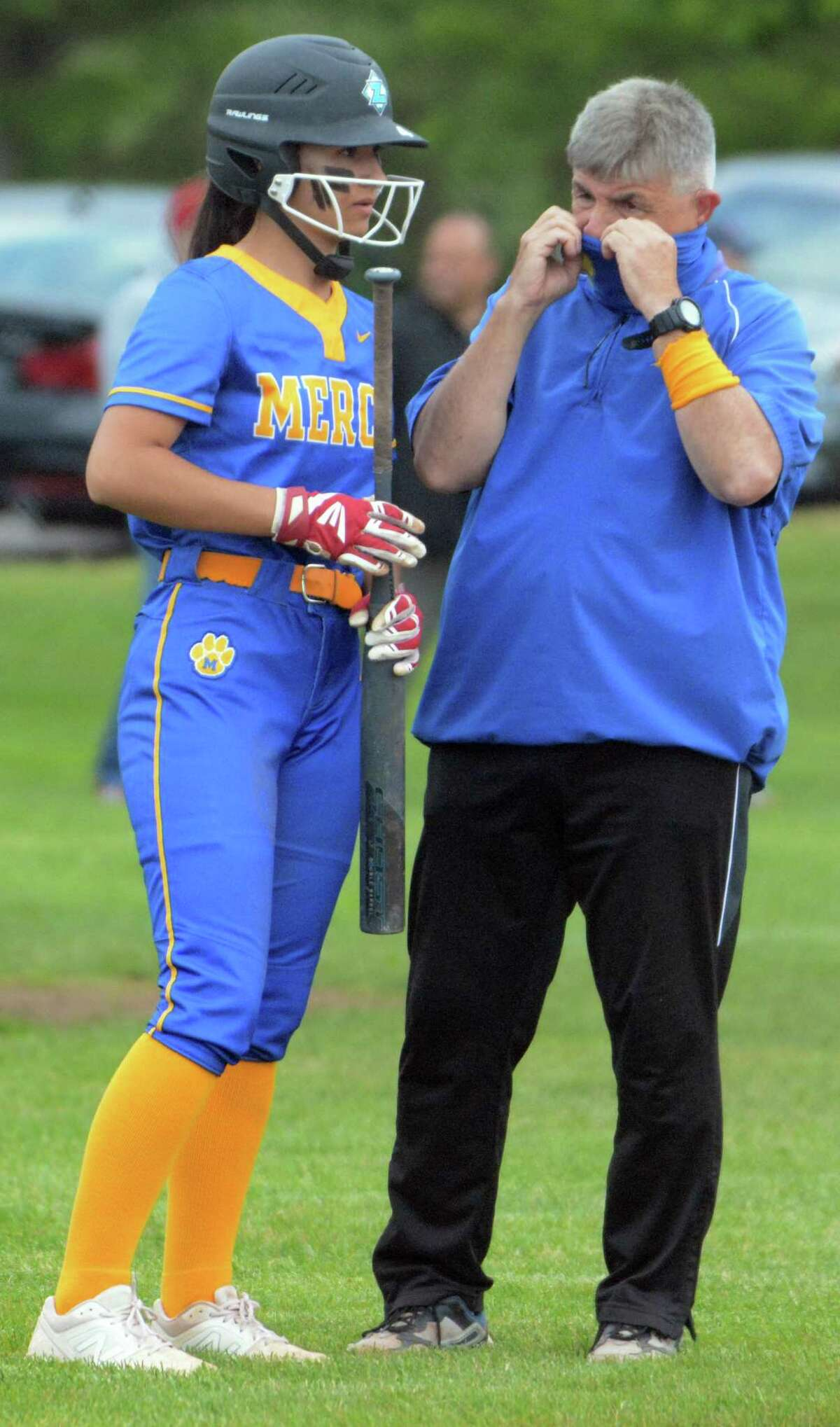 Mercy coach Tony Calcagni and Ashley Deluca talk during Monday's game against East Haven.