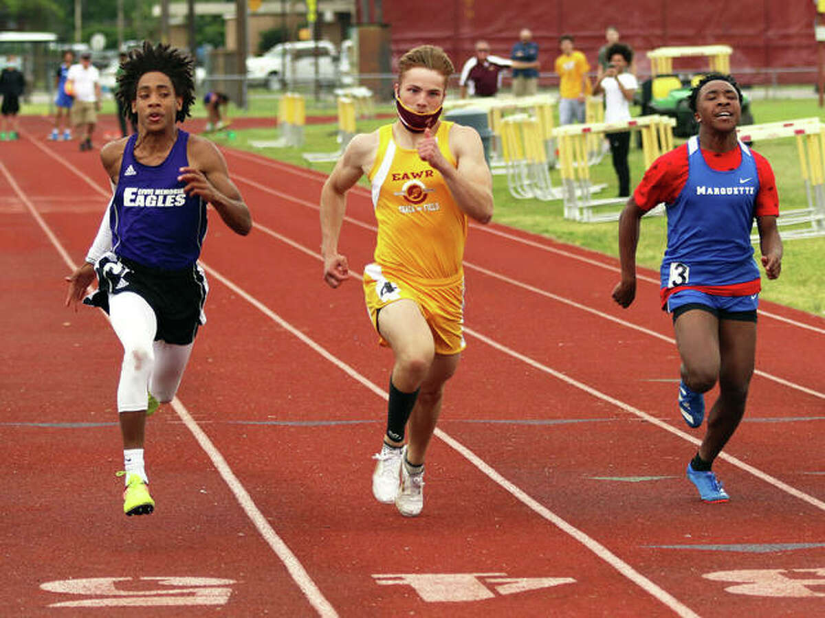 CM's Jordan McMurray (left) beats EA-WR's Pacey Meyer and Marquette Catholic's Johnny Everage to the finish line to win the 100 meters on Monday at the Madison County Small-Schools track meet at Memorial Stadium in Wood River. McMurray won in 12.01 seconds, with Meyer at 12.05 and Everage at 12.18.