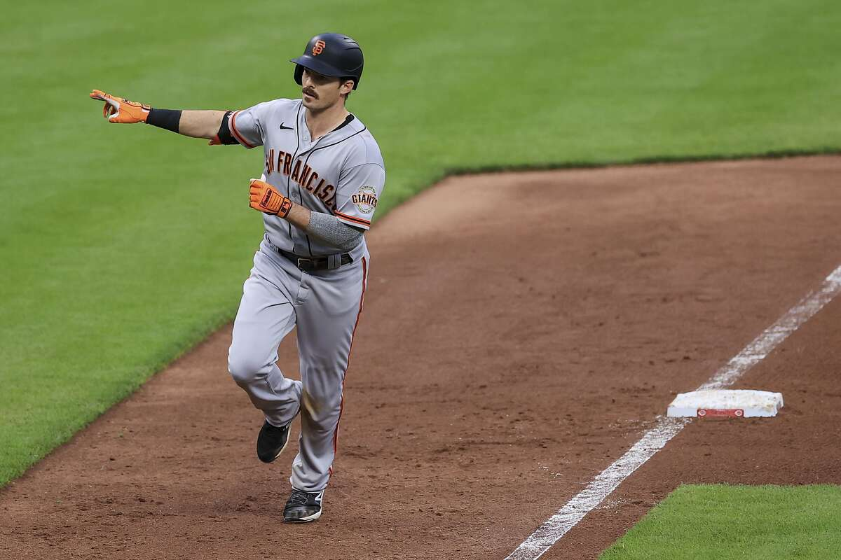 San Francisco Giants' Mike Yastrzemski reacts while running the bases after hitting a solo home run during the fifth inning of a baseball game against the Cincinnati Reds in Cincinnati, Monday, May 17, 2021. (AP Photo/Aaron Doster)