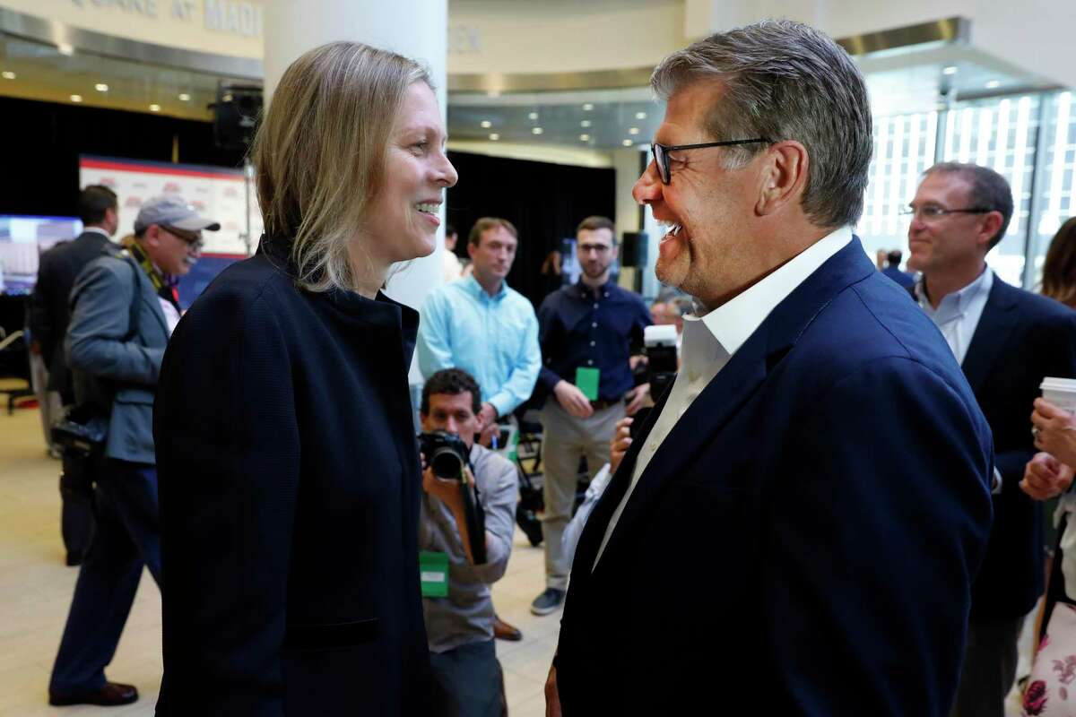 UConn women's basketball coach Geno Auriemma, right, talks with Big East Commissioner Val Ackerman before the announcement that UConn is re-joining the Big East Conference, at New York's Madison Square Garden, in 2019.