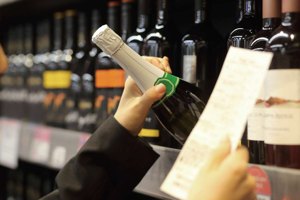 Liquor store business has decreased since last spring, but is still significantly higher than 2019, shop owners said, and the shift to more online orders instead of in-person orders is stretching workers thin.