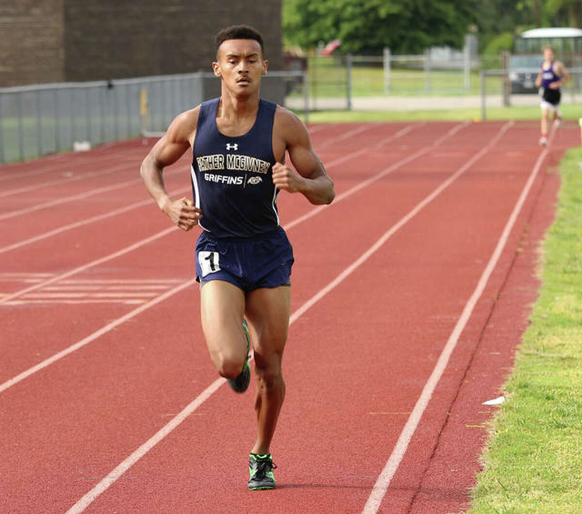 Father McGivney's Tyler Guthrie competes in the 1,600-meter run during the Madison County Small School Meet on Monday in Wood River.