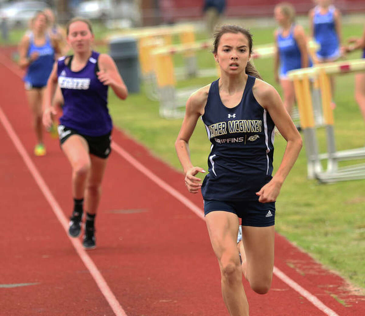 Father McGivney freshman Kaitlyn Hatley approaches the finish line for a win in the 800-meter run during the Madison County Small School Meet on Monday in Wood River.