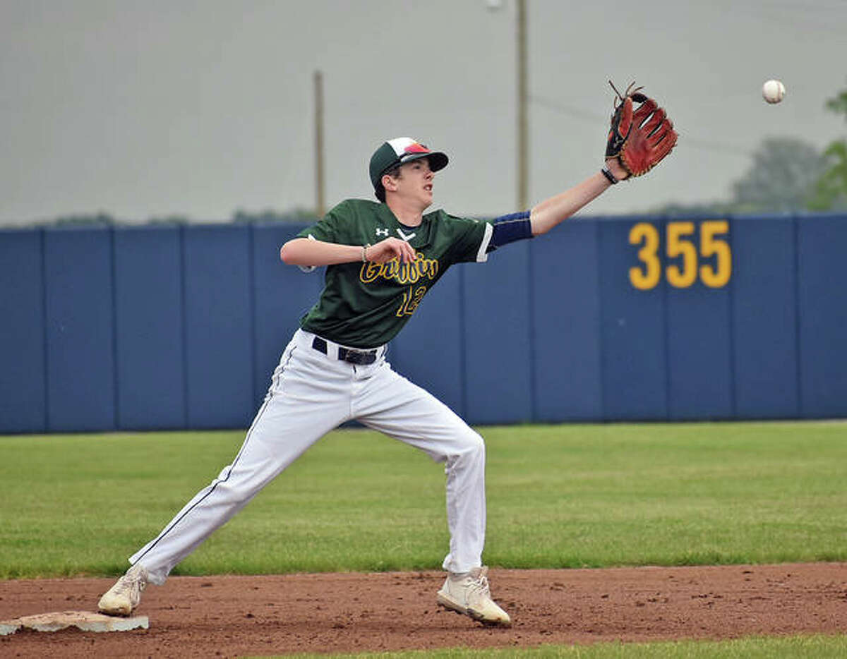Father McGivney's Ryker Keller reaches for a throw at second base for a force-out in the first inning against Nokomis.