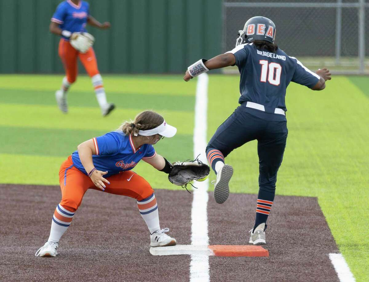 Grand Oaks second baseman Allie Hagebusch (2) attempts to out Jaelyn Simmons #10 of Bridgeland during the third inning of a Region II-6A quarterfinal one-game playoff at Tomball Memorial High School, Friday, May 14, 2021 in Tomball.