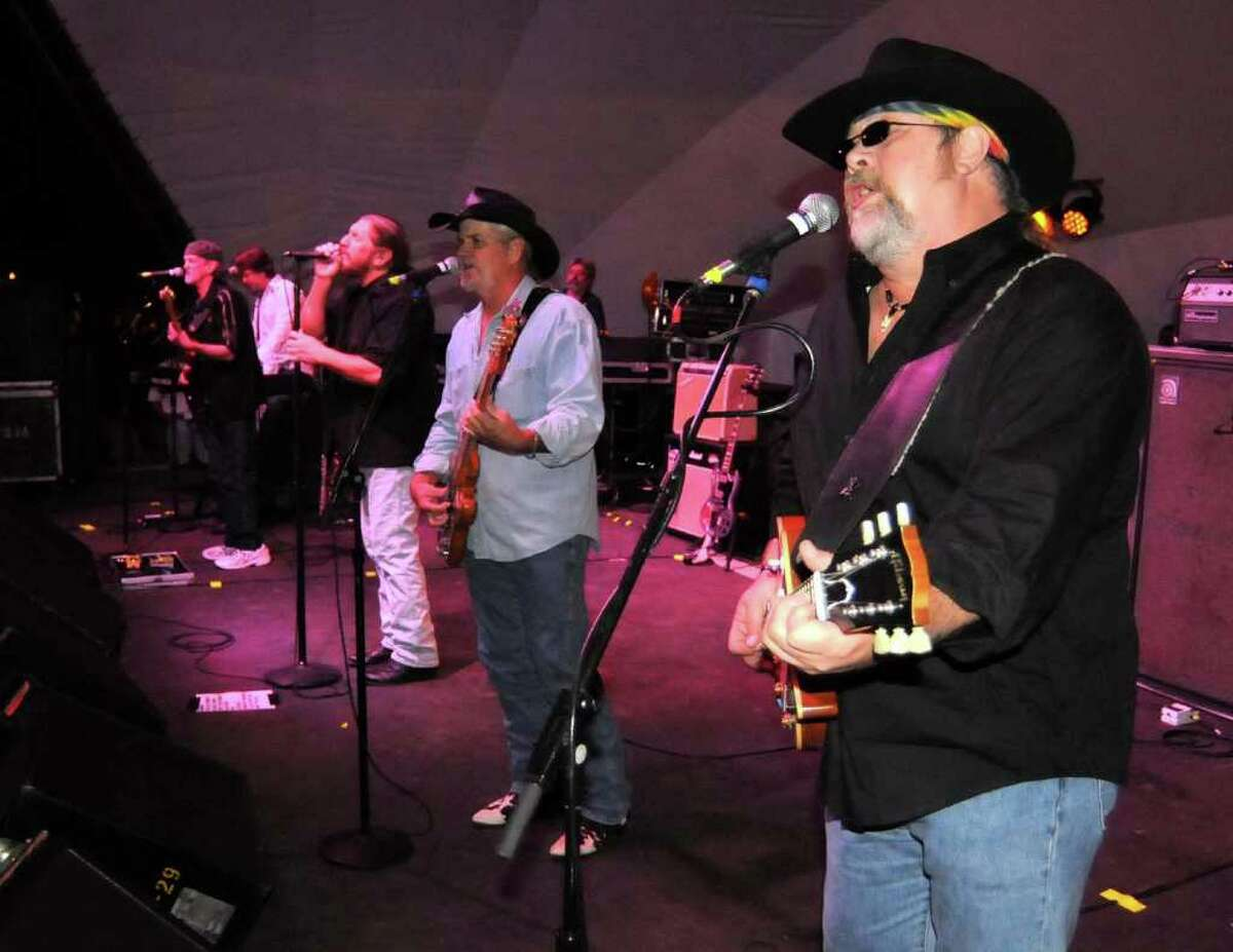The 39 year old Marshall Tucker Band performs in the Danbury Green bandshell as part of the summer concert series on Saturday, Sept. 11, 2010. L to R Stuart Swanlund, guitar, Marcuss Henderson, sax & piano, Doug Gray, lead vocals, original member, Pat Ellwood, bass, and Rick Willis, guitar.