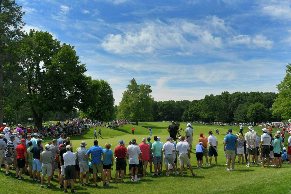 Fans watch play on the fourth hole during the second round of the Travelers Championship at TPC River Highlands in 2018 in Cromwell.