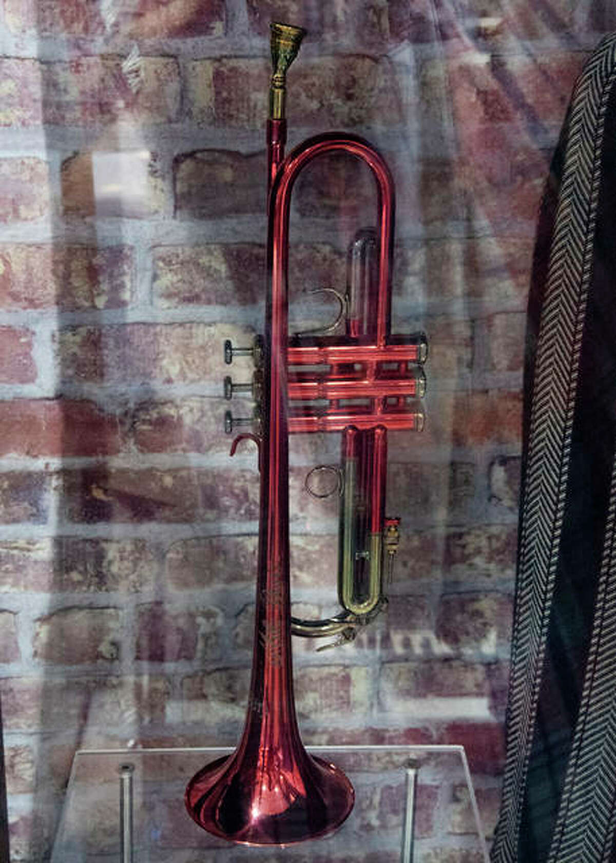Miles Davis' custom made red trumpet is part of the