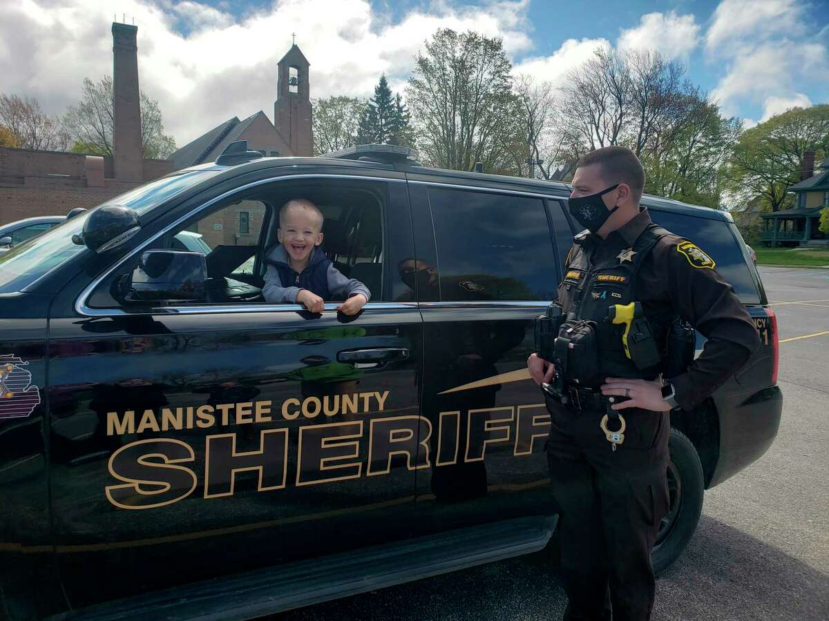 Manistee County Sheriff'sOfficeDeputy Jason Traeger let preschool students at Trinity Lutheran School check out his police cruiser. (Courtesy photo)
