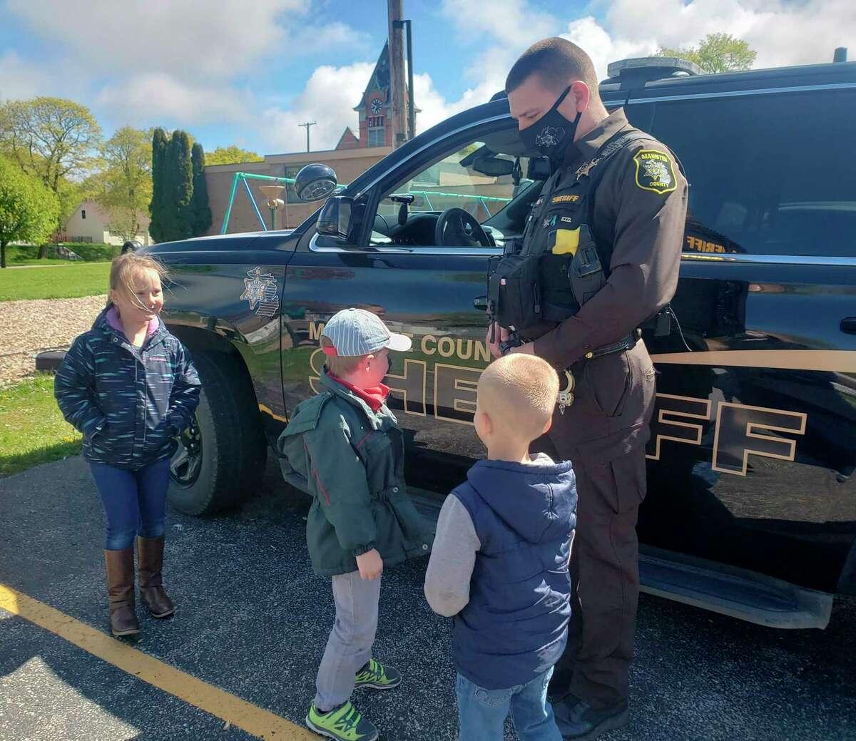 Trinity Lutheran preschool teacher Lynne Gatz hopes a visit from Manistee County Sheriff'sOfficeDeputy Jason Traeger willmake her students feel comfortable talking with law enforcement. (Courtesy photo)