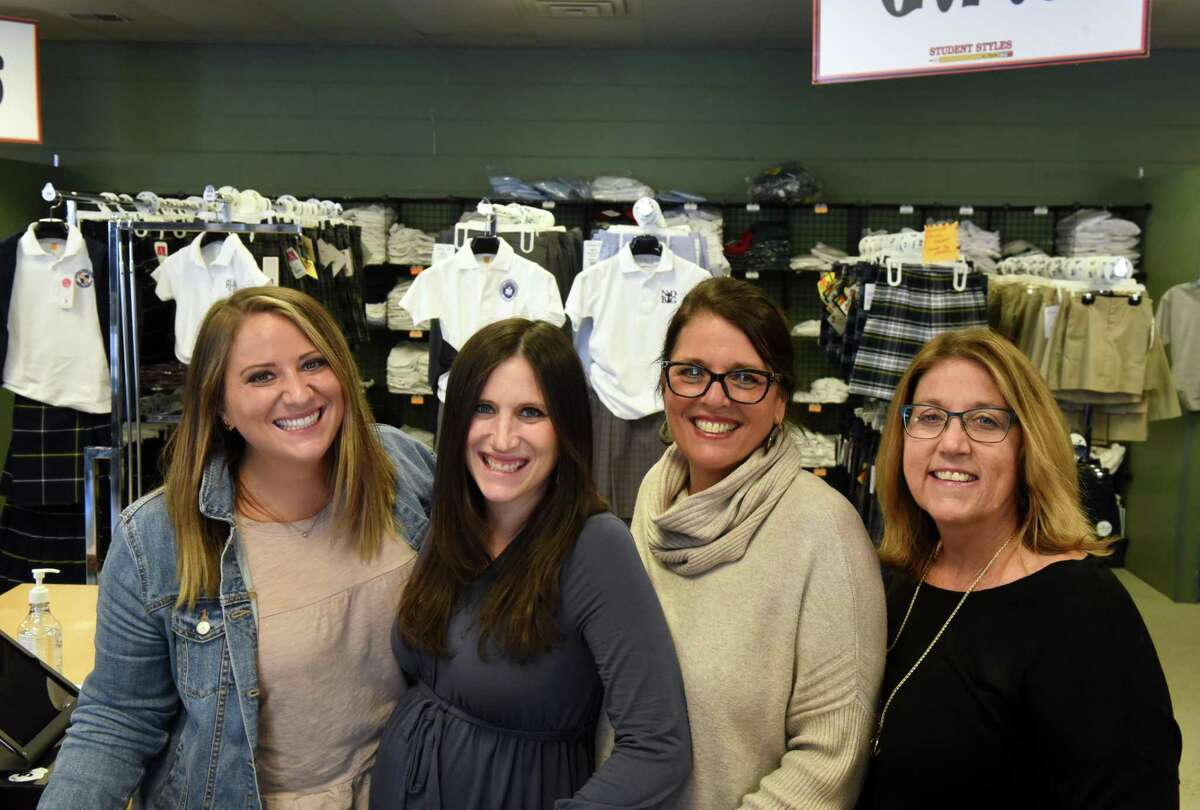 Student Styles family members; Alex Smith, left, Jennifer Wade, Christi Smith and Sharon Pizzo, right, stand for a photo at their family workplace on Monday, March 22, 2021, in Colonie, N.Y. (Will Waldron/Times Union)