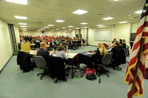 The Greenwich Board of Education meets on Nov. 21, 2019 before a packed community room at Greenwich High School in Greenwich, Connecticut. The Board of Education will make its return to regular, in-person — socially distanced — business meetings this Thursday for the first time since before the COVID-19 pandemic.