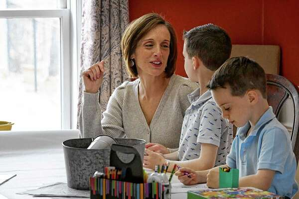 Tara O'Leary spends time with her sons, Mason, 8, center, and Nicholas, 6, right, while working from home on Friday, April 2, 2021, in Colonie, N.Y. (Will Waldron/Times Union)