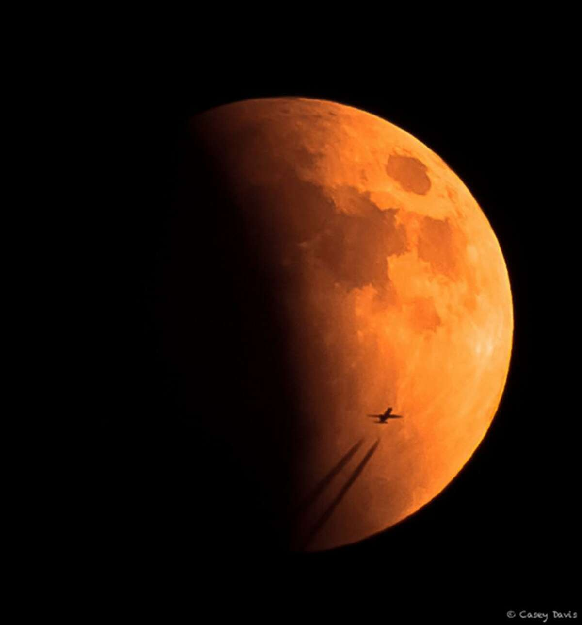 """NASA held a social media photo contest on Facebook during the Sept. 27, 2015 """"super blood moon."""" This picture, entered into the competition, was taken by Casey Davis using a Canon T3I DSLR with the lens being a Canon EFS 55-250mm."""
