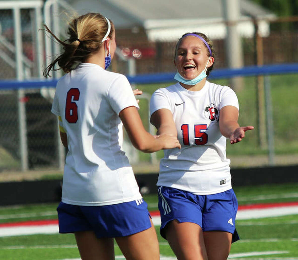 Roxana's Makenna John (right) had an assist and teammate Macie Lucas had a goal and an assist in their team's 7-0 SCC win over Gillespie Monday. They are shown celebrating earlier this season against Carlinville.