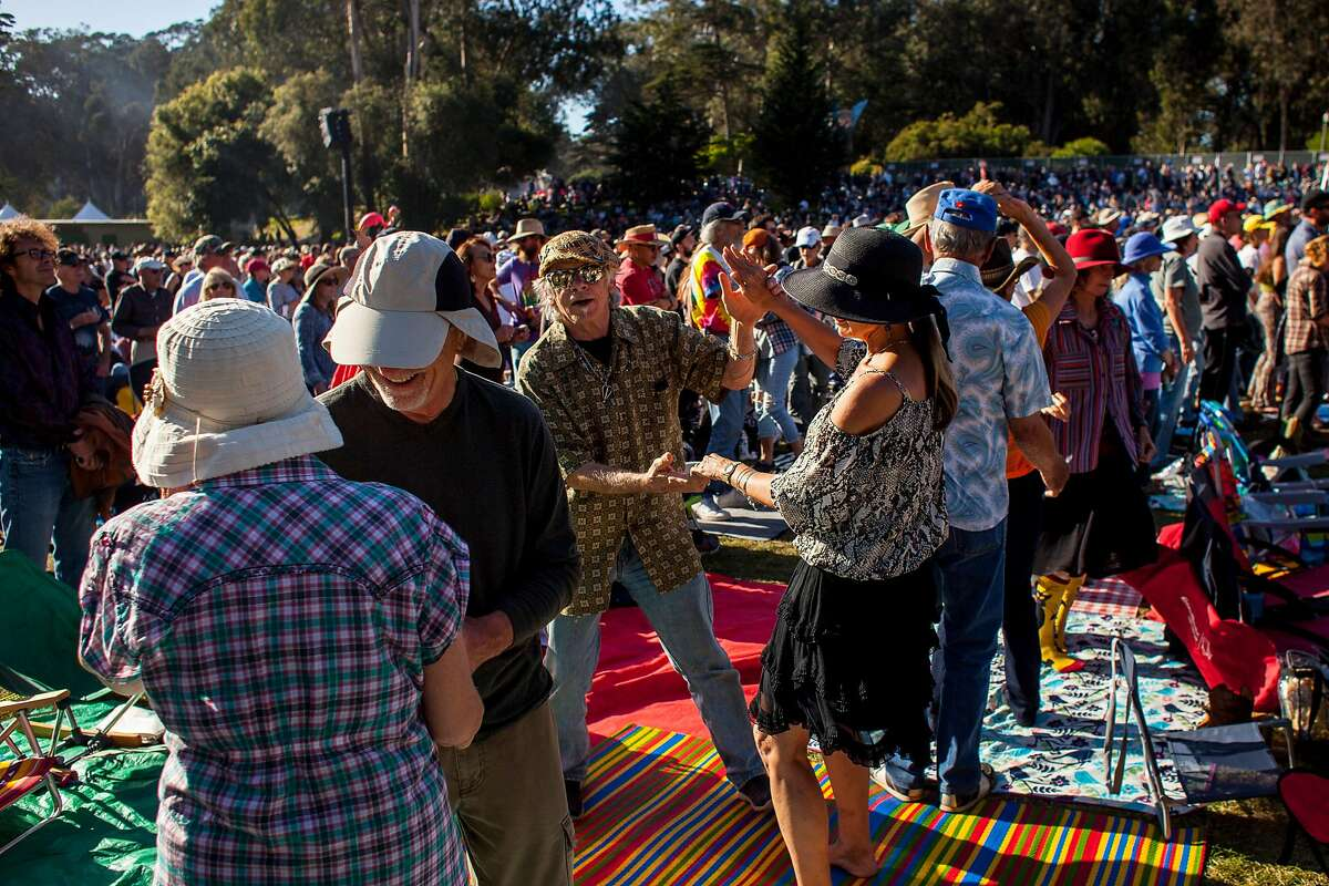 Hardly Strictly Bluegrass concert goers dance to Tanya Tucker at the Banjo Stage on Friday Oct. 4, 2019 in San Francisco, Calif.