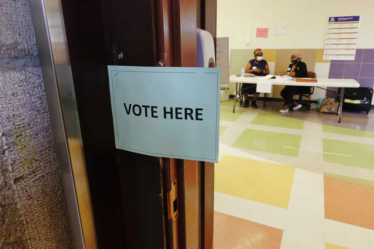 Poll workers await voters at William S. Hackett Middle School for the school budget vote on Tuesday, May 18, 2021, in Albany, N.Y. (Paul Buckowski/Times Union)