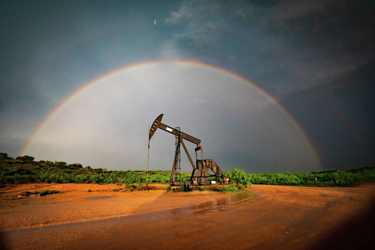 A rainbow is visible near oil and gas production equipment after a storm cell moved through the Permian Basin May 17, 2021. MANDATORY CREDIT: The Oilfield Photographer, Inc.