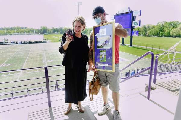 Cecilia Marques, left, the mother of former UAlbany soccer player, Kaio Dasilva, and her son Fabio Dasilva talk with Kaio on a video call during a graduation event at UAlbany on Tuesday, May 18, 2021, in Albany, N.Y. Kaio Dasilva, the first in his family to graduate college, could not attend the event because he is playing soccer professionally in Tennessee, so his mother came to walk across the stage for him. (Paul Buckowski/Times Union)
