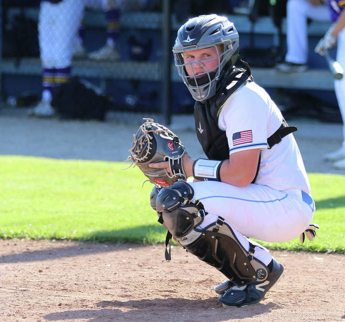Jersey catcher C.J. Brunaugh looks into the dugout for a sign in last week's game against CM in Jerseyville.