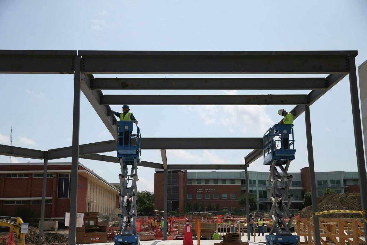 Workers at a construction site on the San Antonio College campus last May. SAC and the four other Alamo Colleges will move most courses online for the first two weeks of the fall semester.