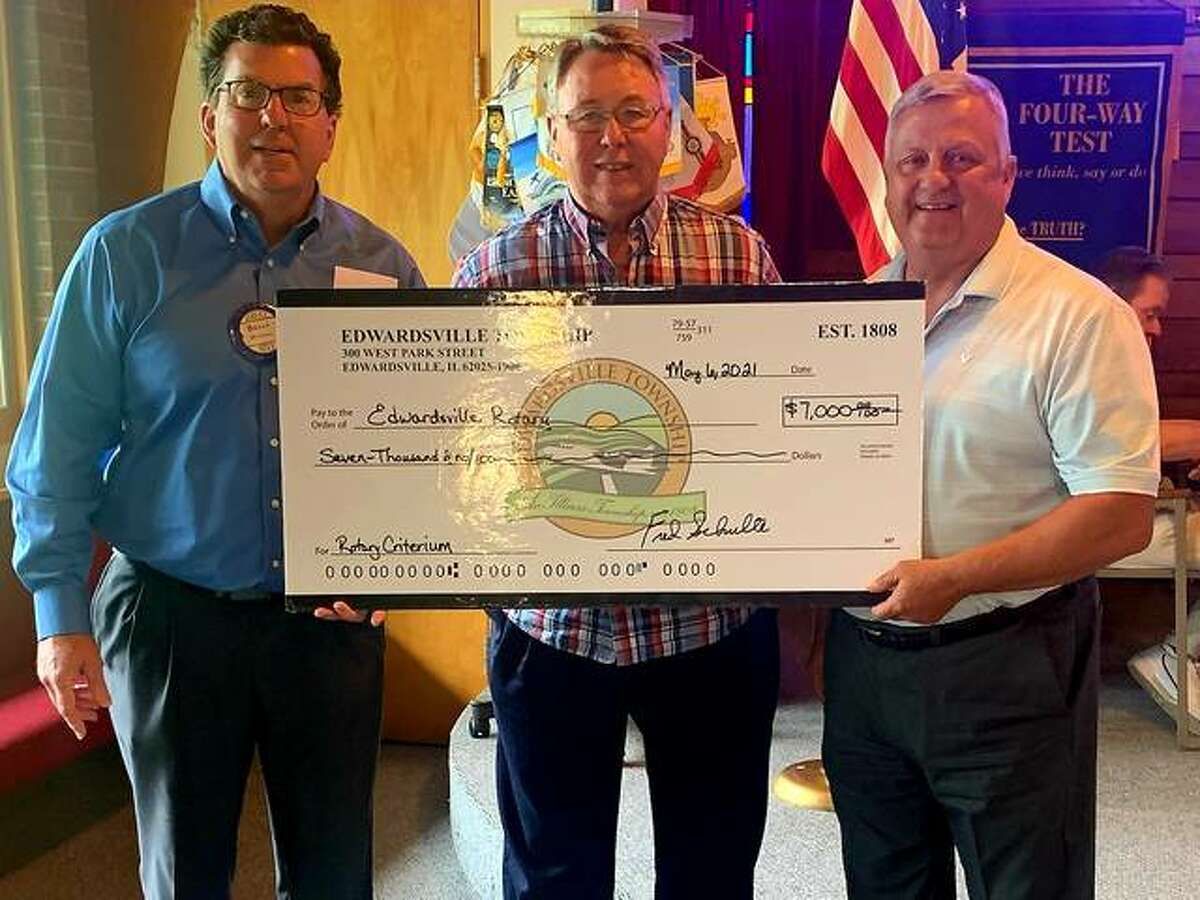 from left to right: Rotarian and Criterium Race Director Brian Mulhall, Edwardsville Township Supervisor Fred Schulte, and Edwardsville Rotary Club President Marc Voegele