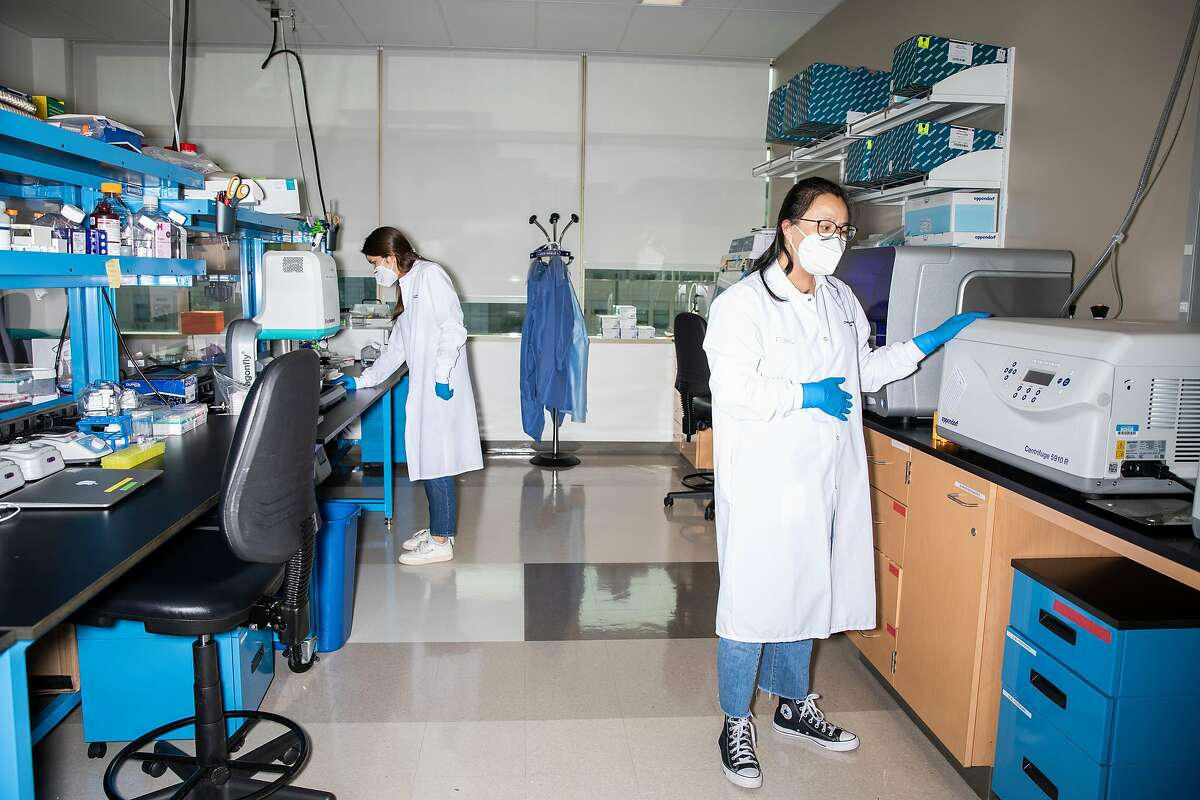 Research Associates Gabrielle Lee, left, and Lienna Chan, work inside a pre-polymerase chain reaction (PCR) lab at Chan Zuckerberg Biohub in San Francisco, Calif., Thursday, May 13, 2021.