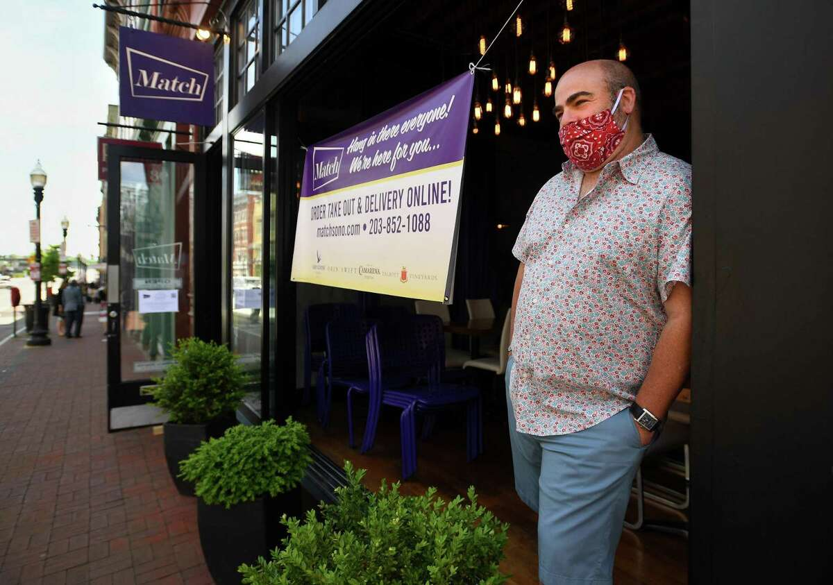 Match restaurant owner and chef Matt Storch waits to meet with Norwalk Mayor Harry Rilling and Lt. Governor Susan Bysiewicz during a walking tour of the Washington Street retail and restaurant district in Norwalk on Wednesday, May 27, 2020.