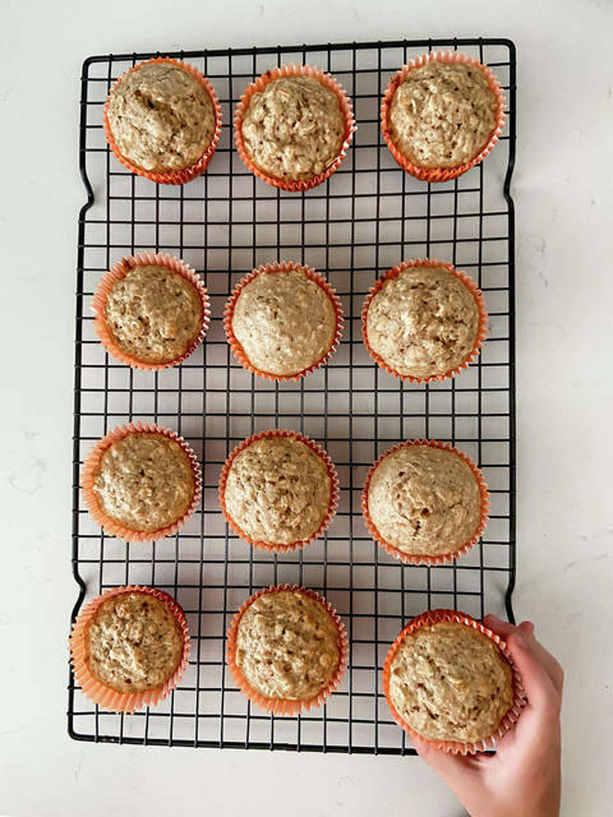 Brown Sugar Oat Muffins are the perfect treat before bed, topped with honey and peanut butter.