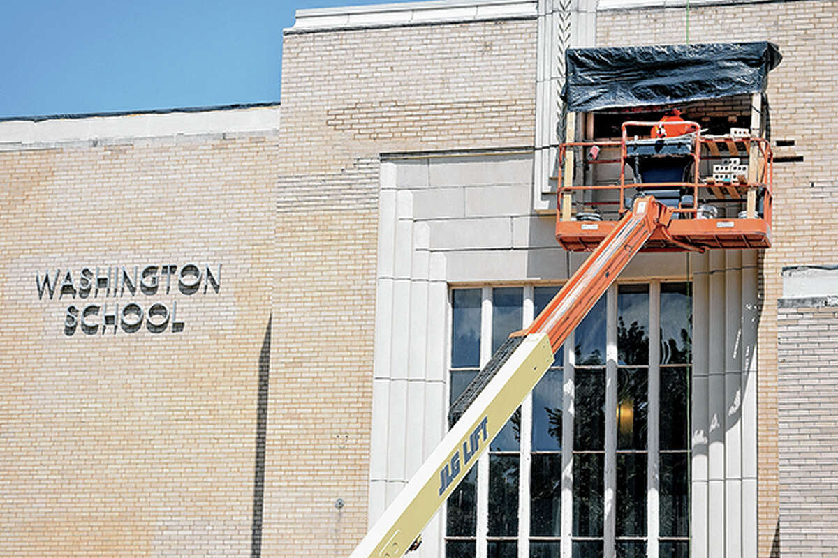 Masonry workers address crumbling facade on the Washington Elementary School building in June 2019.