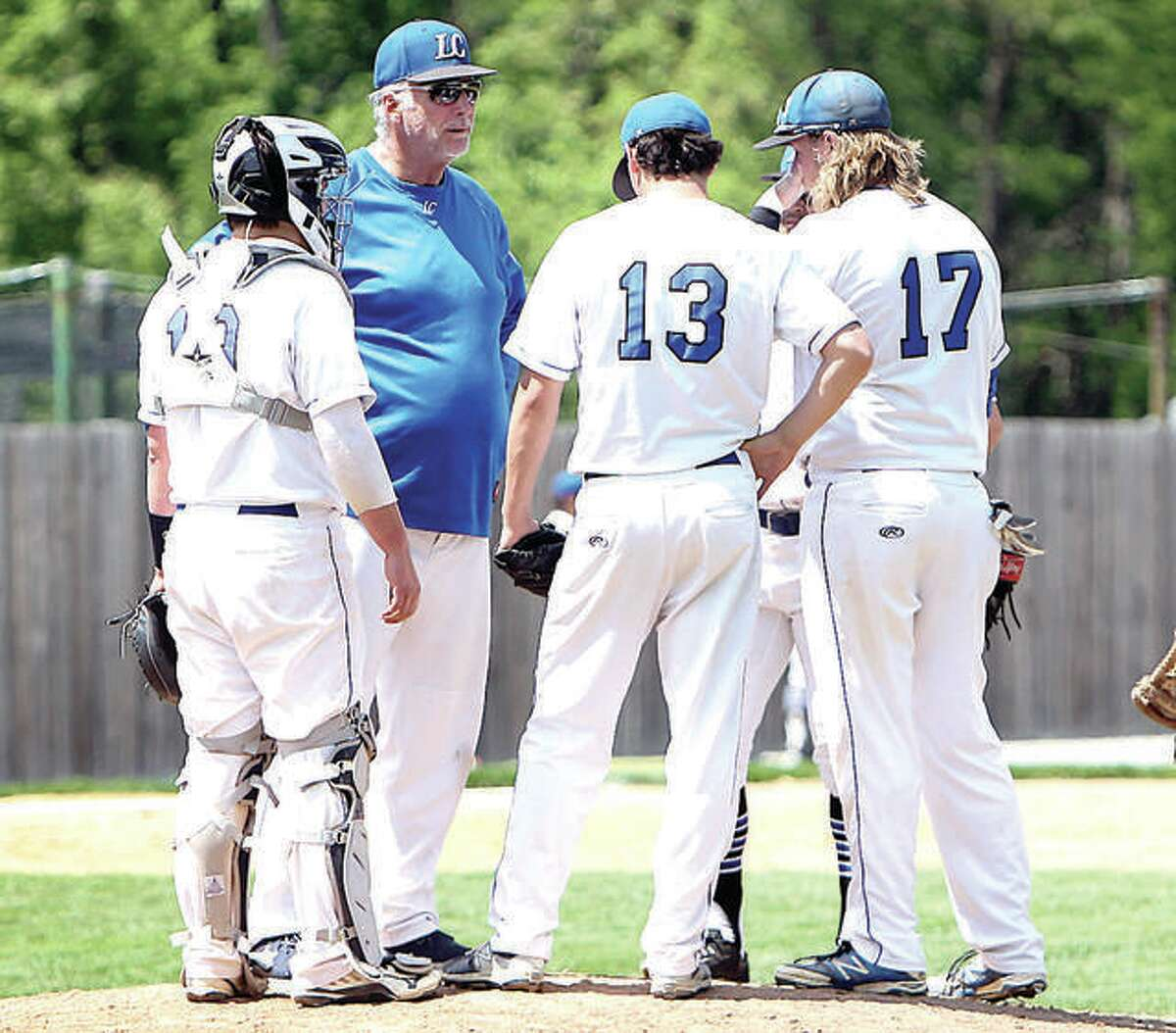 Lewis and Clark Community College baseball coach Randy Martz, second from left, visits the mound during a 2017 game in Godfrey.