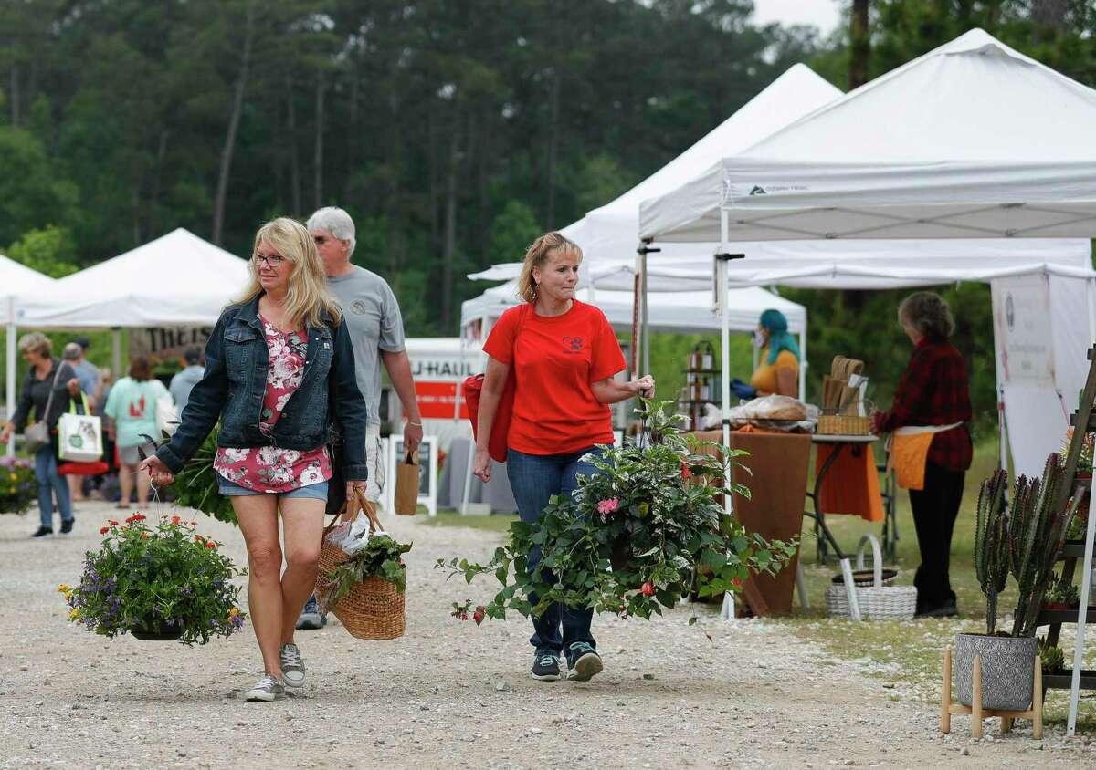 Visitors walk through the Farmer's Market on Tamina, Saturday, April 18, 2020, in Magnolia.