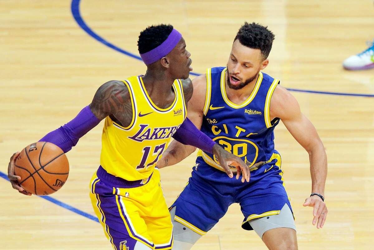 Stephen Curry (30) defends against Dennis Schroder (17) in the first half as the Golden State Warriors played the Los Angeles Lakers at Chase Center in San Francisco, Calif., on Monday, March 15, 2021.