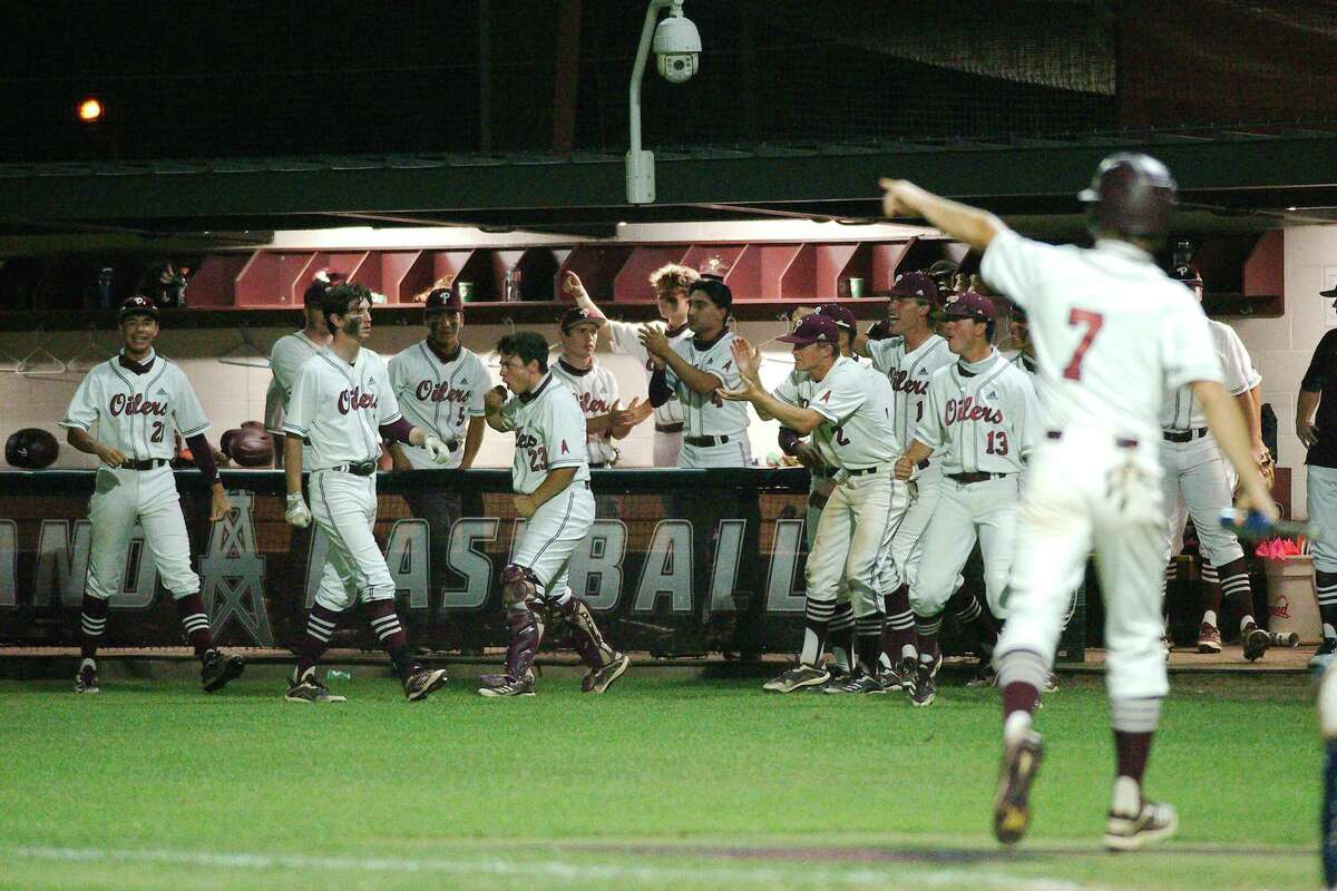 Pearland celebrates after Brett Smajstrla (14) drives in a go-ahead run against Humble Kingwood Thursday at Pearland High School.