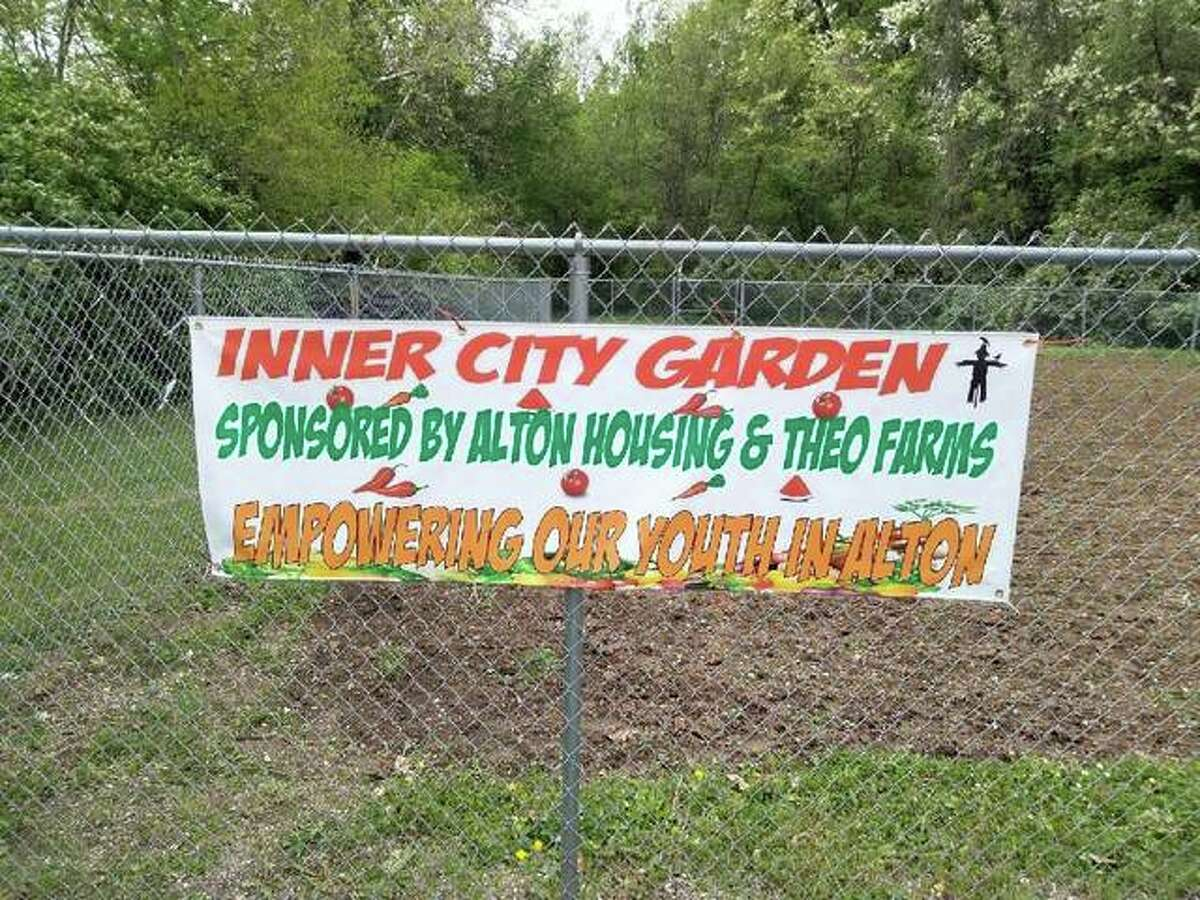 The new Inner City Garden off of Elm Street in Alton, near the former Eunice Smith school, is ready for care by four Alton youth. The program, led by Lee Barham, is sponsored by the Alton Housing Authority in collaboration with Theodora Farm in Godfrey and its manager, Kris Larson.