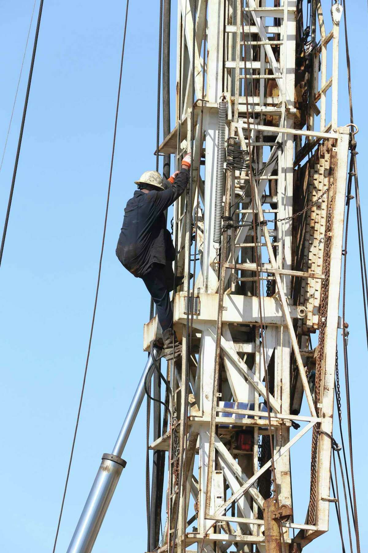 A drilling crew sets up a rig over the Chalk Talk #2 well south of Gonzales, Texas, Friday, April 24, 2020. Millennium Exploration drilled Chalk Talk #2 to a depth of 8,600 feet and went 4,000 feet horizontally in 40 days. They expect 800 barrels a day from the well when completed this Sunday.