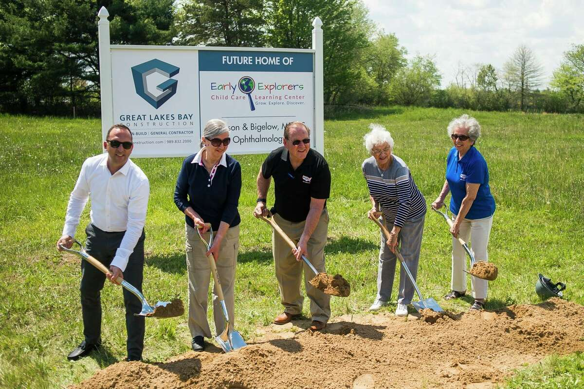 From left, Shawn Pnacek, Lucy Smith, Pat Pnacek, Mary Ann Chritz and Barbara Rice pose for a photo during a groundbreaking ceremony for the Early Explorers Child Care Learning Center and offices of Jackson & Bigelow Opthalmology Monday, May 17, 2021 on Joseph Drive in Midland. (Katy Kildee/kkildee@mdn.net)