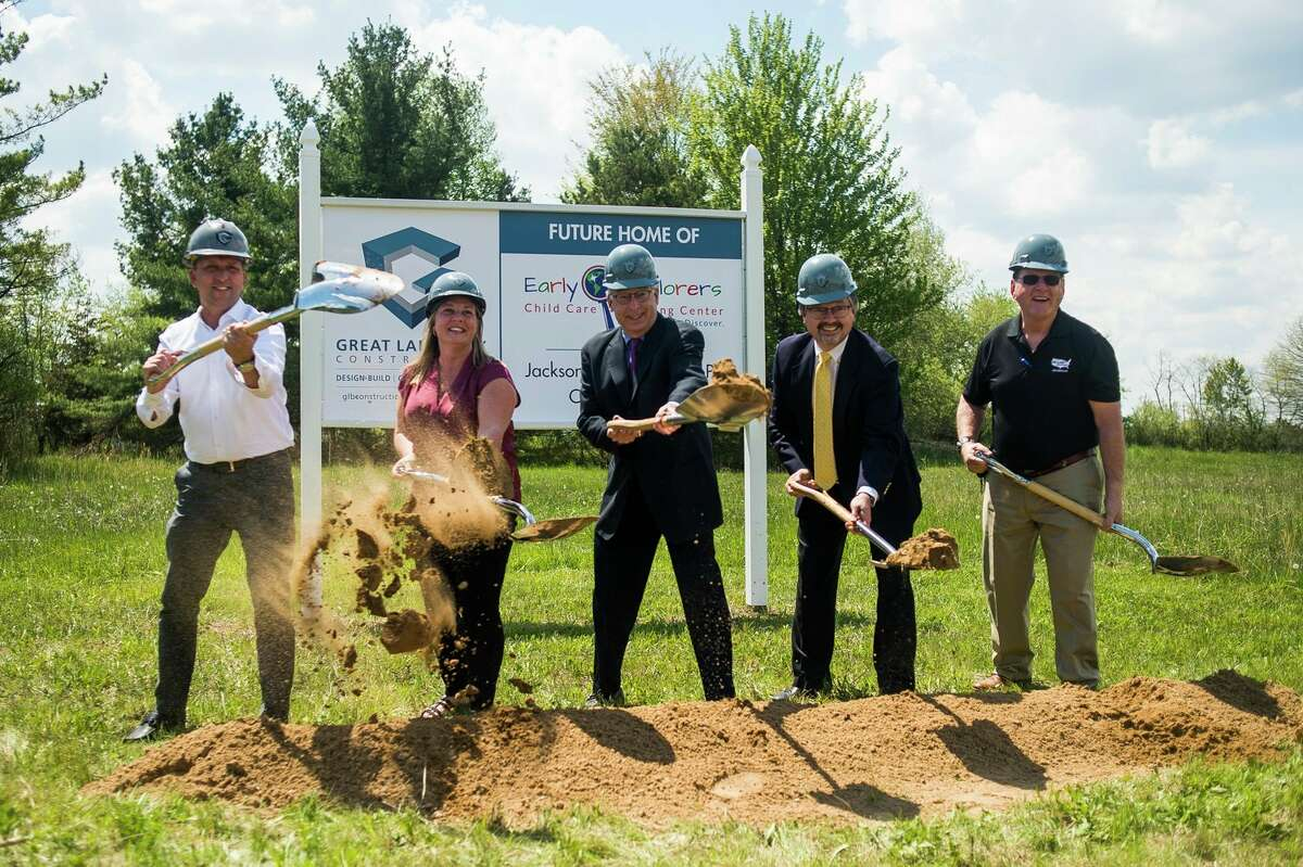 From left, Shawn Pnacek, Jamie Brock, Jim Jackson, Chris Bigelow and Pat Pnacek pose for a photo during a groundbreaking ceremony for the Early Explorers Child Care Learning Center and offices of Jackson & Bigelow Opthalmology Mondaymorning on Joseph Drive in Midland. (Katy Kildee/kkildee@mdn.net)