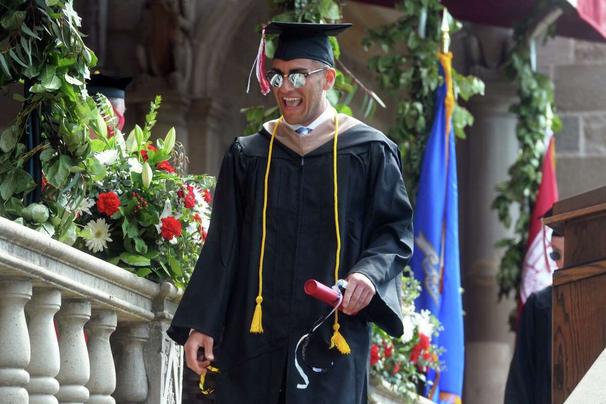 Nasser Eljamal smiles after receiving his diploma during commencement for the Charles F. Dolan School of Business, one of several in-person graduation ceremonies the Fairfield University is holding this week in Fairfield, Conn., May 18, 2021.