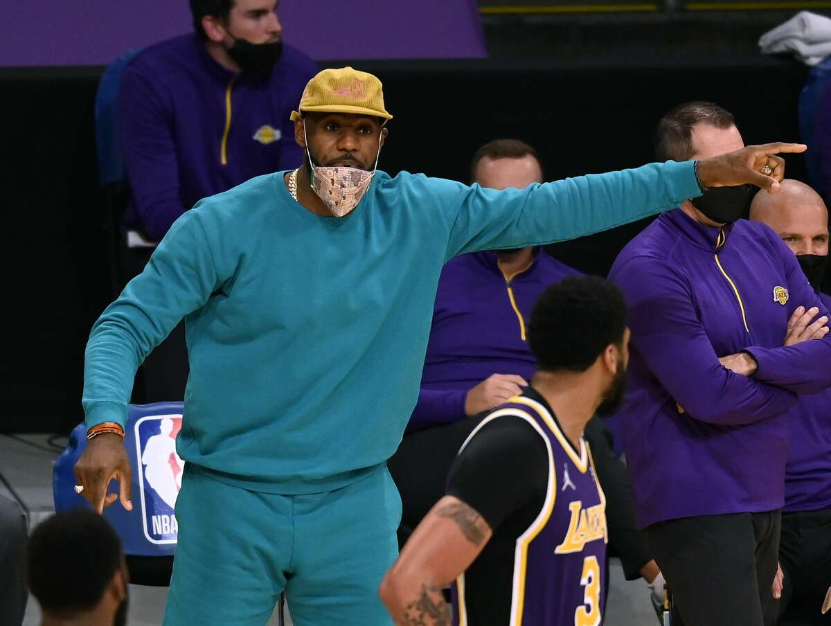 LeBron James of the Los Angeles Lakers reacts to play behind Anthony Davis during the third quarter against the New York Knicks on May 11, 2021.