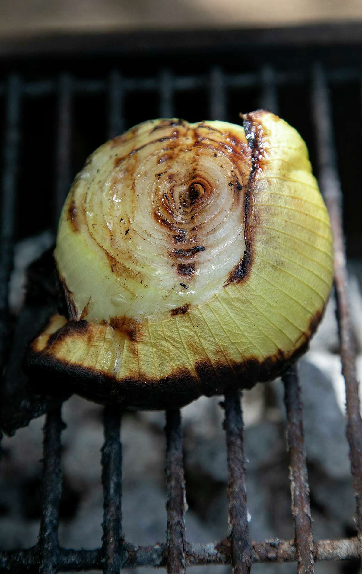 After about 30 minutes on the grill, a harsh onion is transformed into a sweet treat.
