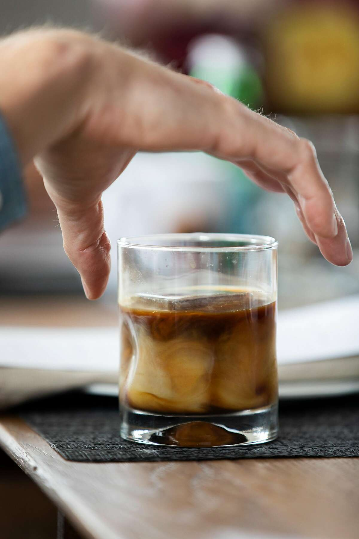 Hunter Pence adds milk to his Rise + Grind cold brew at home, Friday, May 14, 2021, in San Francisco, Calif. Hunter, a former baseball star with the San Francisco Giants, and his spouse Alexis Pence, a coffee entrepreneur, are opening a new coffee shop.