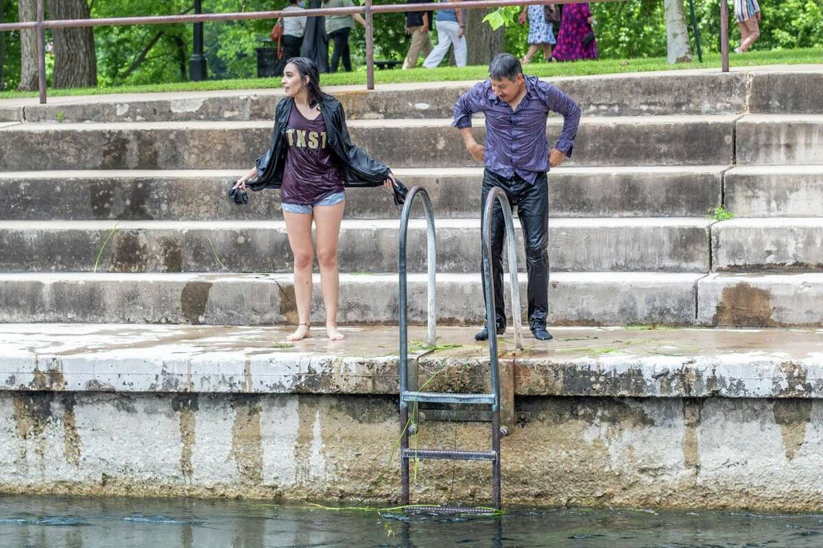 It's not a Texas State University graduation without a San Marcos River jump in full commencement garb and for one new alumna, it wouldn't be a milestone family moment, without her dad beside her in drenched pants and a button-down shirt.