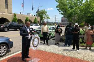 Corrie Betts, chairman of the criminal justice committee of the state NAACP, speaks at a press conference in front of the Bridgeport police department about a video that appears to show a police officer holding a gun to someone's head.
